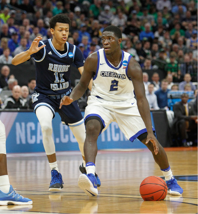 Creighton guard Khyri Thomas (2) drives to the basket against Rhode Island defender Jeff Dowtin (11) during a first-round game in the NCAA college basketball tournament in Sacramento, Calif., Friday, March 17, 2017. (AP Photo/Steve Yeater)