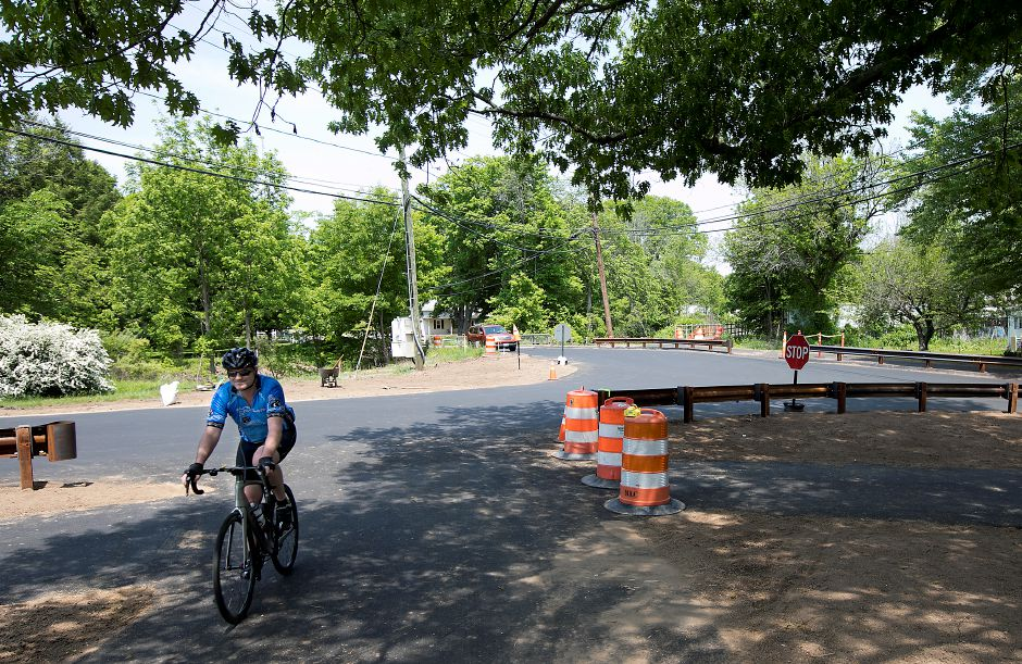 A cyclist pedals through the intersection of Hart and Curtiss Streets near the linear trail in Southington, Friday, May 25, 2018. Dave Zajac, Record-Journal