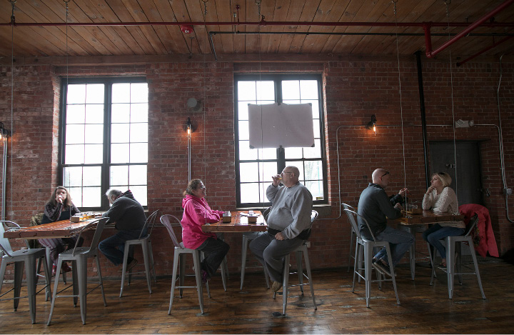 Patrons of Witchdoctor Brewing Company sample brews at the new business in Factory Square on Center Street in Southington, Wednesday, April 26, 2017.  | Dave Zajac, Record-Journal