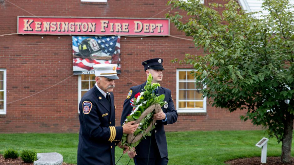 Berlin firefighters carry a wreath to the Kensington Fire Rescue Company