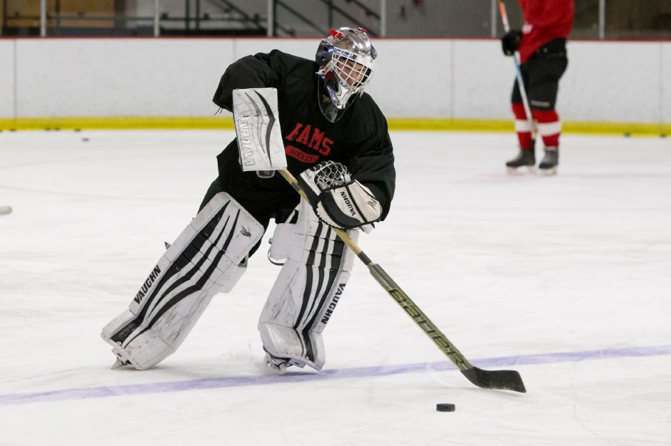 Cheshire goalie Anthony Vignola had 35 saves as the Rams skated to a 2-2 tie Saturday with the Farmington Valley Generals, the top-ranked team in Division II hockey. | Justin Weekes / Special to the Record-Journal