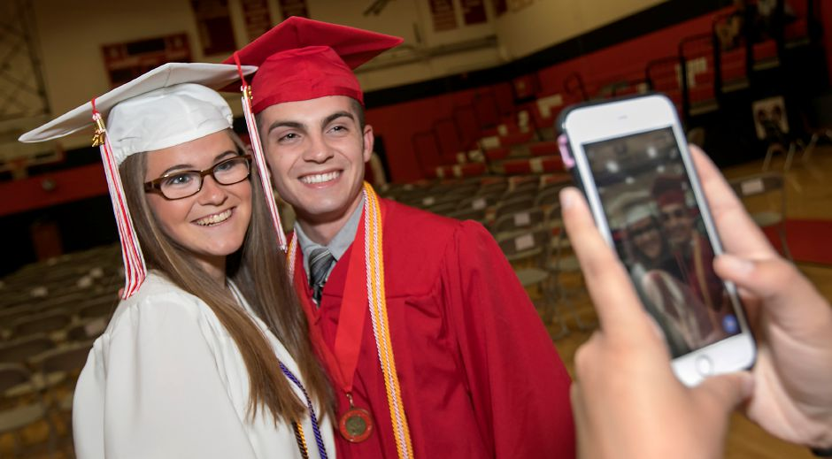 Graduates Katie Bartlett and Matthew Mita smile for a photo prior to graduation ceremonies at Cheshire High School, Wednesday, June 14, 2017. | Dave Zajac, Record-Journal