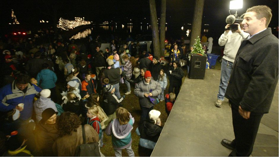 Mayor Mark Benigni led the crowd in cheering to light the holiday lights in Hubbard Park Tues. night, Nov. 26, 2002. A sound meter was used with the loudest yell triggering the lights to turn on.
