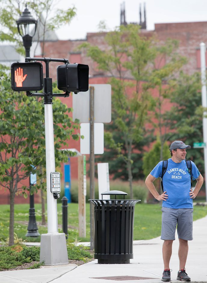 U.S. Senator Chris Murphy waits to cross State Street in Meriden during his walk across Connecticut, Tuesday, August 15, 2017. | Dave Zajac, Record-Journal