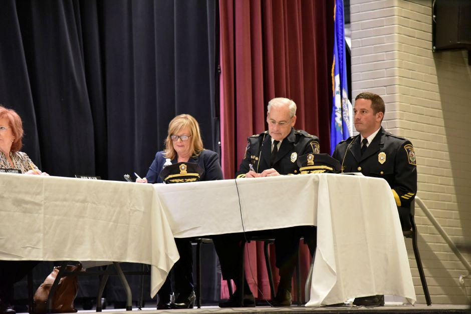 North Haven Police Chief Thomas J. McLoughlin (left) and Deputy Chief Kevin Glenn during the board of police commissioners meeting at the North Haven Middle School on Jan. 15, 2019. Four policemen were promoted during the meeting. | Bailey Wright, Record-Journal