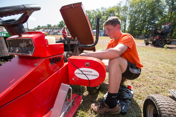 Keaton McGill 16 of Bolton makes repairs to his tractor before making a pulling attempt Sunday during the 75th Annual North Haven Fair in North Haven September 10, 2017 | Justin Weekes / For the Record-Journal