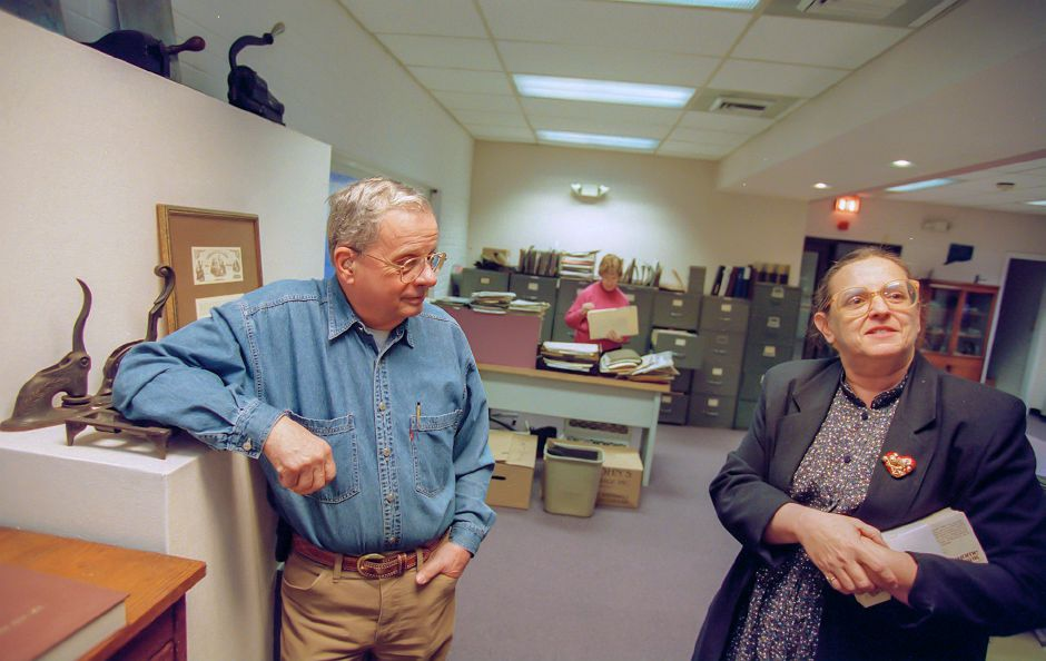 RJ file photo - Ken Cowing, board member of former president of the Meriden Historical Society, chats with Rita Picciafochi, current president, Dec. 1998.
