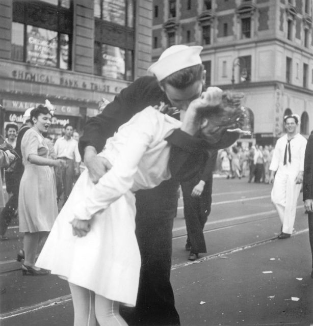 A sailor and a woman kiss in Times Square, as people celebrate the end of World War II. The  sailor, later identified as  George Mendonsa, died Sunday at 95.