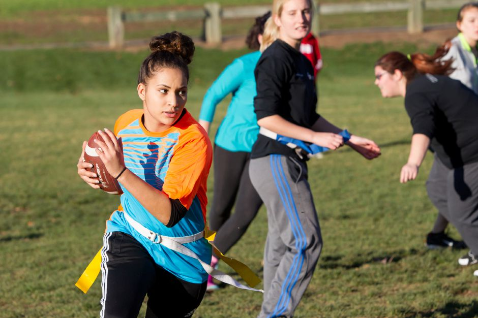 Zenab Chovai runs during powder puff practice Friday at Wilcox Tech in Meriden Nov. 13, 2015 | Justin Weekes / For the Record-Journal