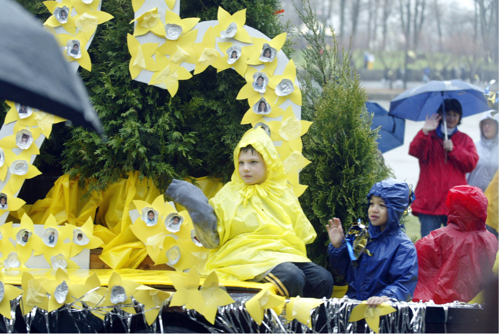 "The St. Stanislaus School float, with a large yellow ""25"" made out of paper daffodils with photos of students in the center, Sat., April 26 during the 25th annual Daffodil Festival parade."