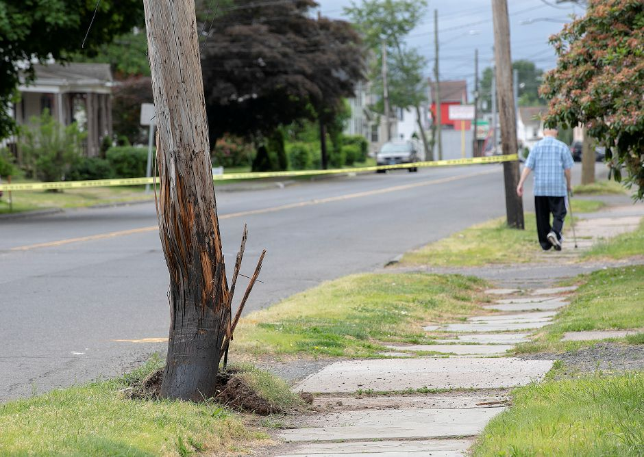A utility pole damaged by a motor vehicle on Broad Street near Silver Street in Meriden, Mon., June 10, 2019. Silver Street to Ann Street is closed to traffic after police said a car crashed into a pole and the driver attempted to flee the scene. Dave Zajac, Record-Journal