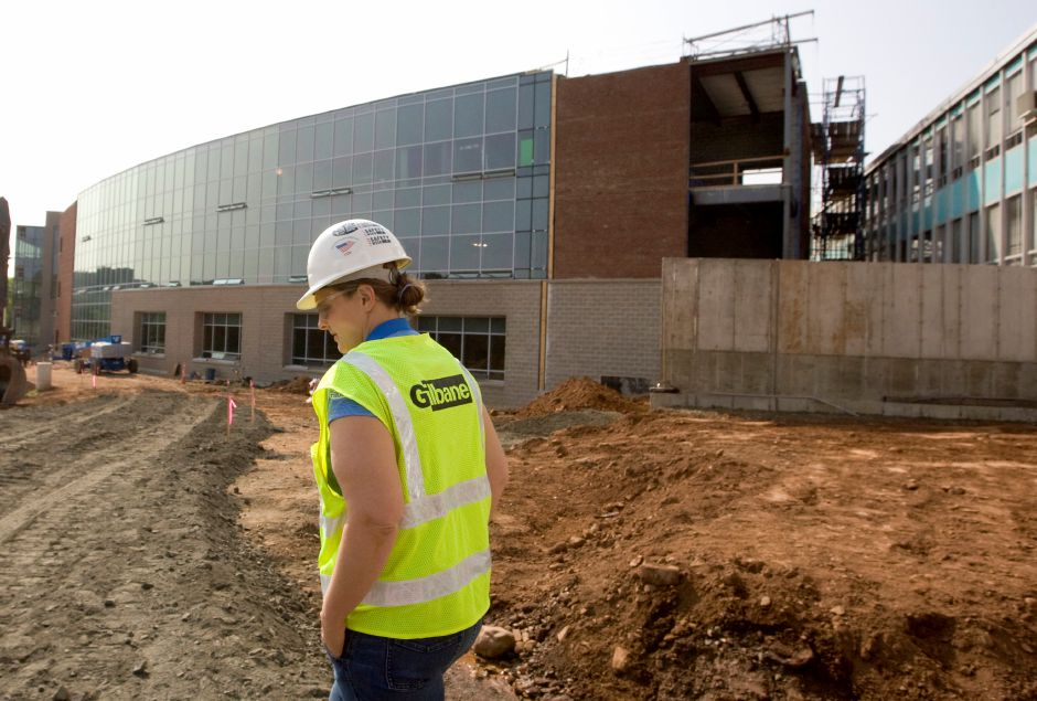 Karrie Kratz, a project manager for Glastonbury-based Gilbane Building Co., walks the site of the Maloney High School project, Wednesday July 30, 2014. The school is undergoing extensive renovations including the construction of a three-story classroom wing. | Dave Zajac / Record-Journal