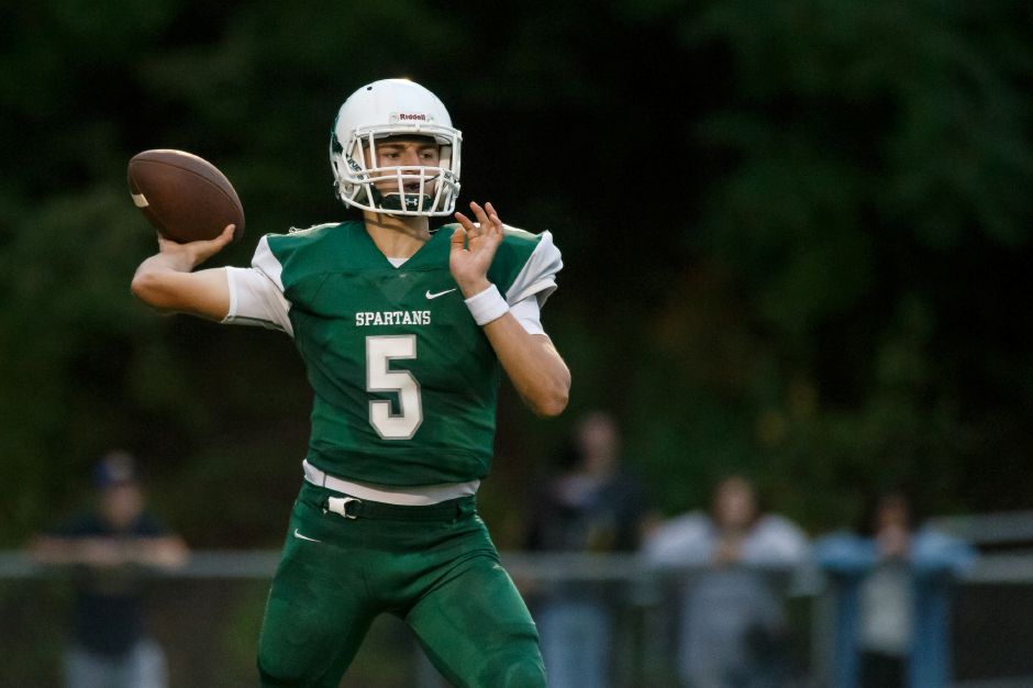 Maloney quarterback Elliot Good threw four touchdown passes and the Spartans put up 60 points in defeating Bristol Eastern on Friday and improving to 3-0. | Justin Weekes / Special to the Record-Journal