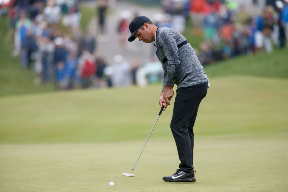 Paul Casey sinks a birdie putt to cap his 8-under round on Saturday, which gives him a four-shot lead heading into Sunday's final round at the Travelers Championship at TPC River Highlands. | Justin Weekes / Special to the Record-Journal