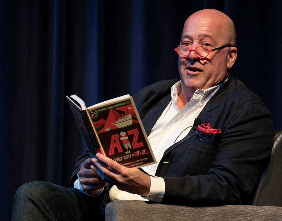 "Author Andrew Zimmern reads a chapter from his book ""AZ and the Lost City of Ophir"" to Meriden students at Platt High School, Wed., May 15, 2019. Zimmern is the globe-trotting host of the ""Bizarre Foods"" TV show. Dave Zajac, Record-Journal"