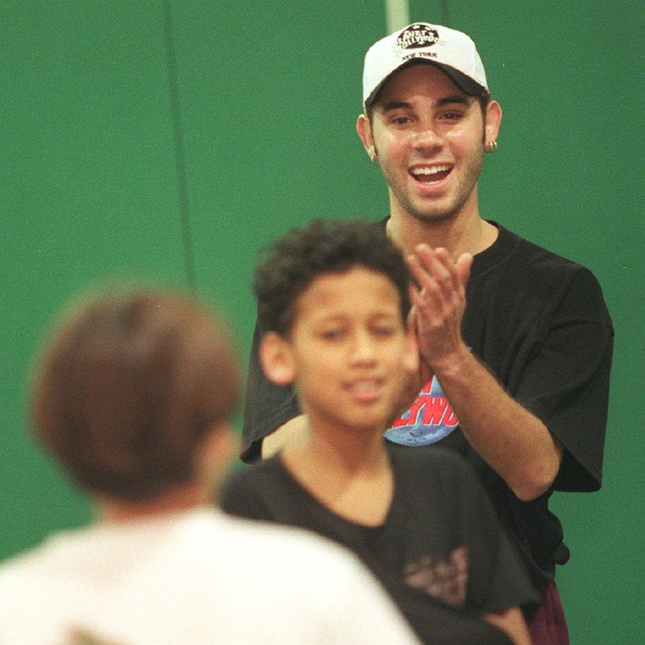 RJ file photo - Danny Oquendo cheers on teammates during a game of indoor football at the Meriden Boys Club, where he volunteers, May 1999.