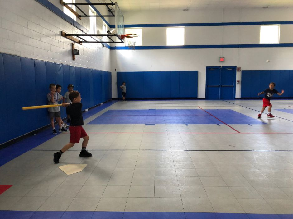 J.C. Collazo plays whiffle ball inside the Ulbrich Boys & Girls Club during summer camp. |Kristen Dearborn, contributed.