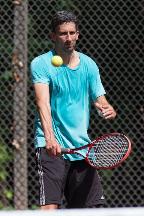 Scott Neufield in the mixed A doubles final Sunday during the Wink Filipek Sr. Memorial Tennis tournament at Copper Valley Swim and Tennis Club in Cheshire Jun. 11, 2017 | Justin Weekes / For the Record-Journal