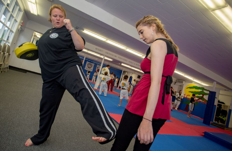 Jennifer Couture, master instructor and owner of JC Karate in Cheshire, takes Record-Journal Digital Content Producer Ashley Kus through some of the techniques people will learn in an upcoming women
