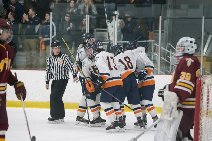 Lyman Hall celebrates the power play goal from Markus Trahan to put the Trojans on the board Saturday at Northford Ice Pavilion in Northford Feb. 20, 2016 | Justin Weekes / For the Record-Journal