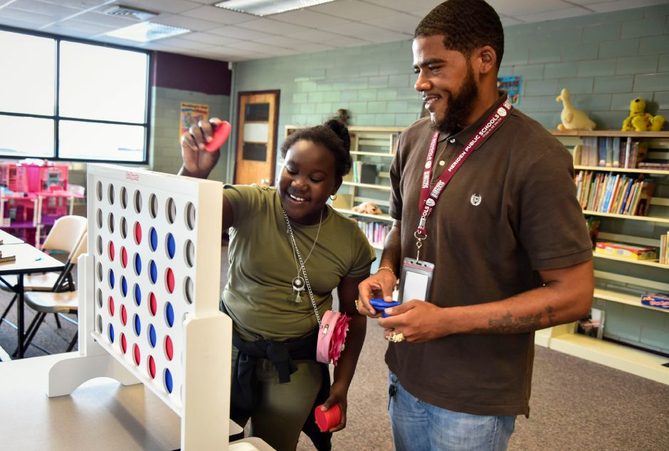 Boys & Girls Club mentor Henry Rhodes (right) plays connect four with Aniyah Slater, 11, who goes to Lincoln Middle School, at the club on Wednesday, Sept. 19. The club is looking to expand its mentorship program. | Bailey Wright, Record-Journal