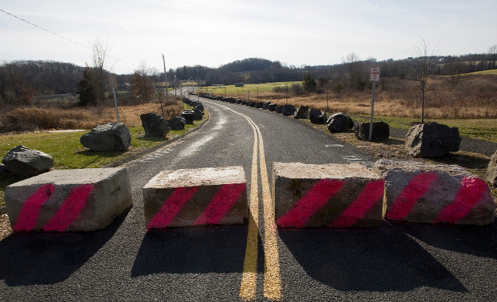 Concrete blocks prevent access to a portion of Vietnam Veterans Memorial Park in Wallingford, Tuesday, December 13, 2016. The barricade was set up to deter potential illegal dumping.  | Dave Zajac, Record-Journal