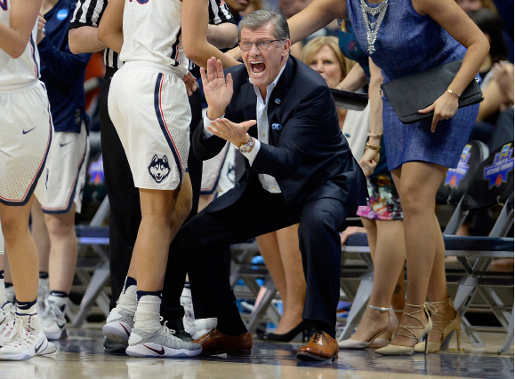 Connecticut coach Geno Auriemma applauds during the first half of the team