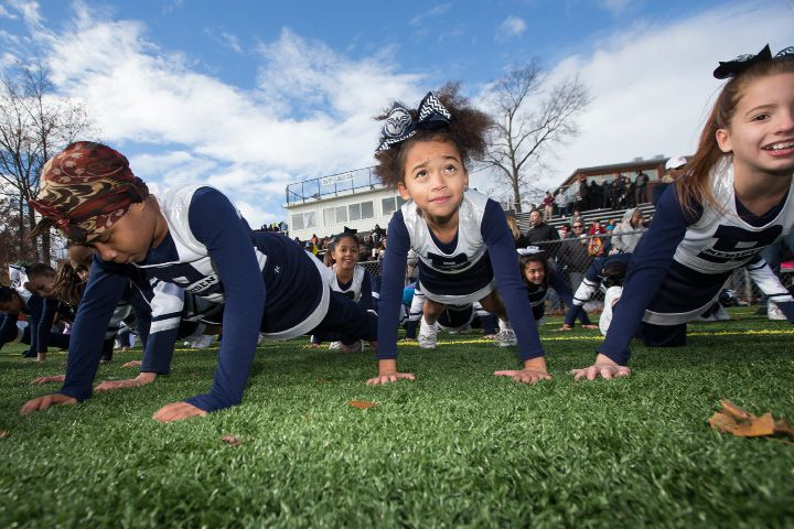 Meriden Raiders cheerleaders Kariah Coles 10 left Queennzingah Nkrumah 9 and Erin Sola 9 do push ups after a touchdown Sunday during the New England championship at Falcon Field in Meriden Nov. 20, 2016 | Justin Weekes / For the Record-Journal