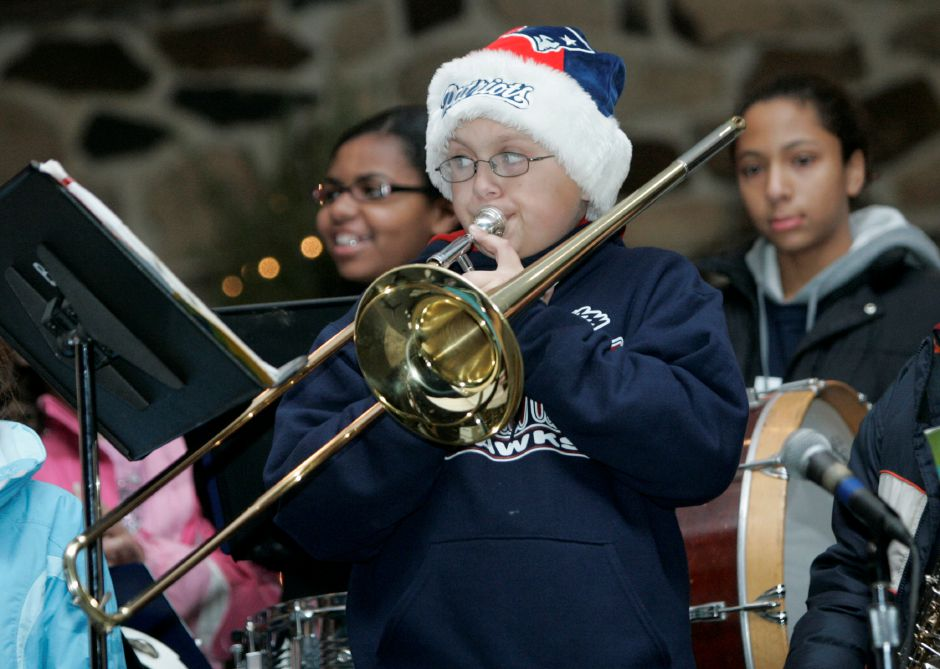 "Record Journal Photo/ Johnathon Heninger 12.09.08 - Max Wrobel from NAthan Hale School in Meriden plays ""Up on the Housetop"" with his trombone at Christmas in the Park in Meriden"