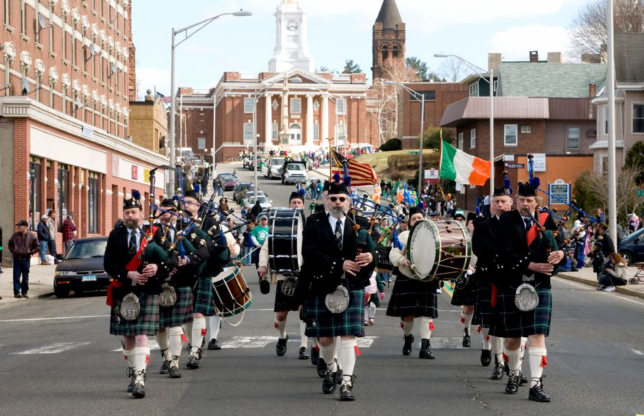 Members of The Taggart Pipes and Drums from Deep River march down East Main Street during the St. Patrick
