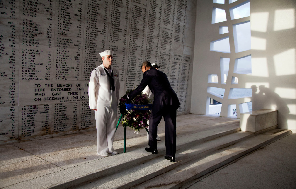 FILE - In this Dec. 29, 2011 file photo, U.S. President Barack Obama lays a wreath at the USS Arizona Memorial, part of the World War II Valor in the Pacific National Monument in Pearl Harbor, Hawaii. Japan