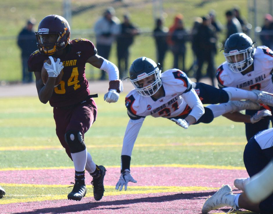 Sheehan's Terrence Bogan breaks free for a long run against Lyman Hall. Bryan Lipiner, Record-Journal