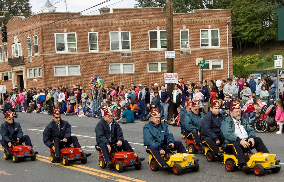 The Newington Shriners motor their miniature cars in formation during the 2010 Apple Harvest Festival Parade in Southington October 3, 2010. (Dave Zajac/Record-Journal)