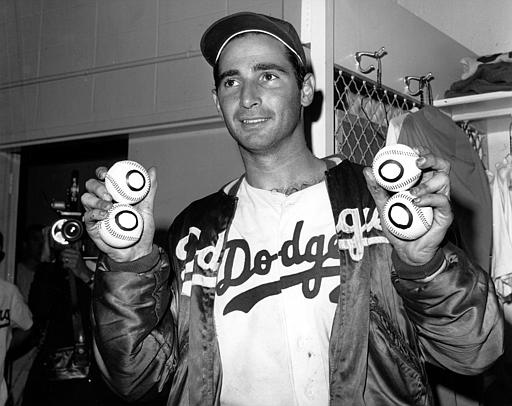 Sandy Koufax, pitcher of the Los Angeles Dodgers, holds up four baseballs in Los Angeles, Ca. on Sept. 10, 1965. It is the day after he pitched a perfect game for a 1-0 win against the Chicago Cubs, making him the first major leaguer to pitch four no-hit games. (AP Photo)