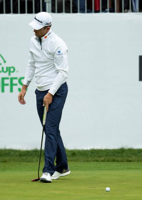 Justin Rose, of England, reacts to missing a putt for par in the playoff hole during the BMW Championship golf tournament at the Aronimink Golf Club, Monday, Sept. 10, 2018, in Newtown Square, Pa. Keegan Bradley held off Justin Rose in a sudden-death playoff to win the rain-plagued BMW Championship for his first PGA Tour victory in six years. (AP Photo/Chris Szagola)