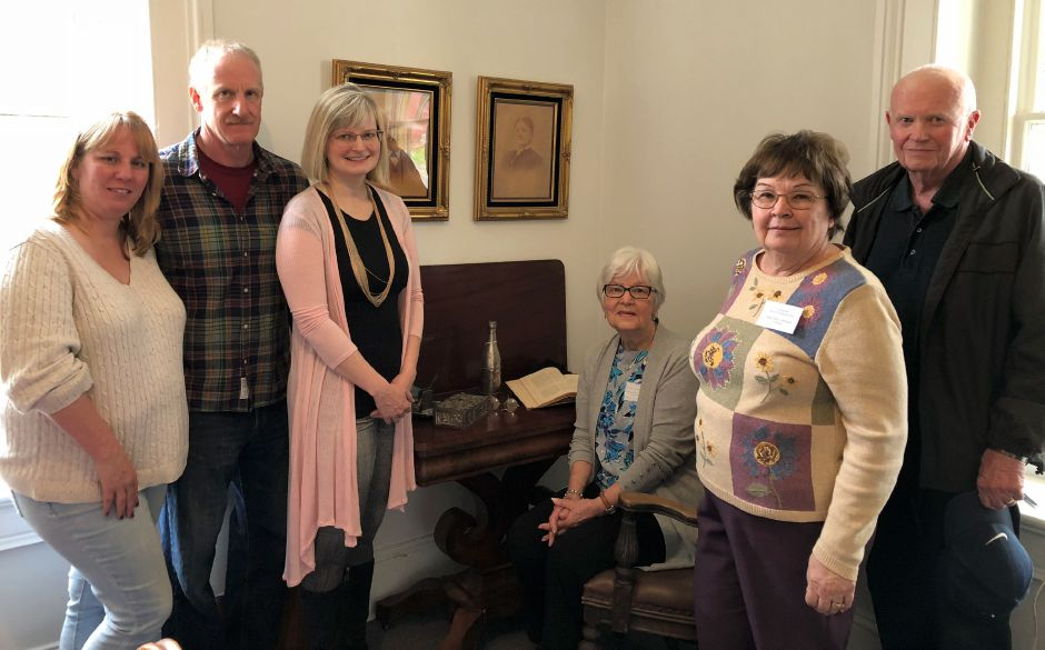 Standing in front of the newly unveiled photos of Franklin and Harriet Johnson are Christine and Rick Homestead, and Kristen Rosenberg. Seated is Linda Homested, Mary Beth Applegate and Peter Homestead.