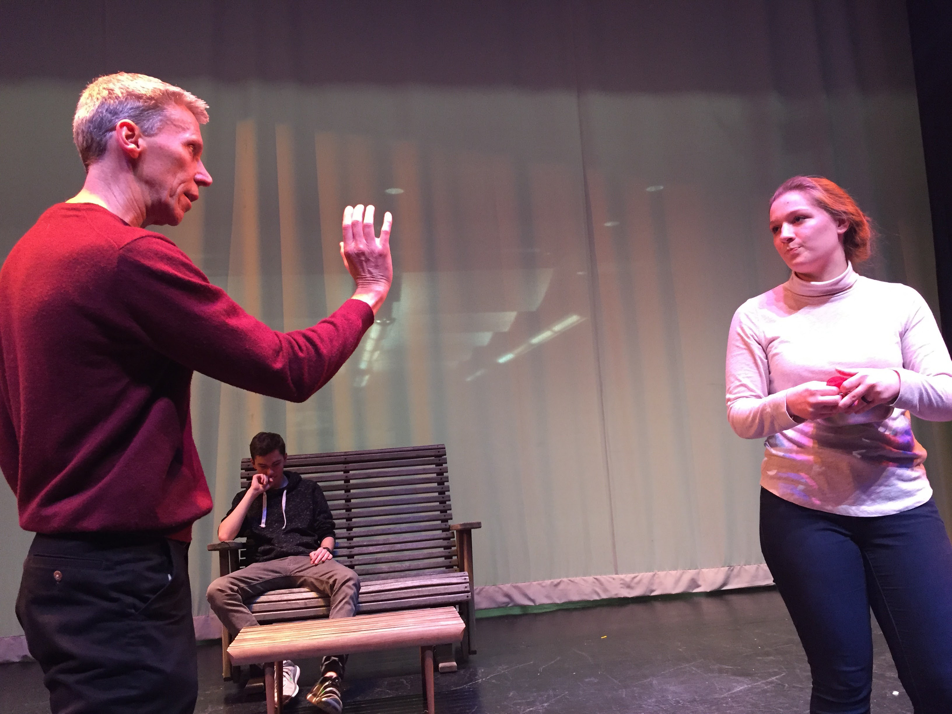 "Director, and school chorus teacher, Jeffrey Blanchette provides direction to student Kloe Hidri in a rehearsal for ""All My Sons."" 