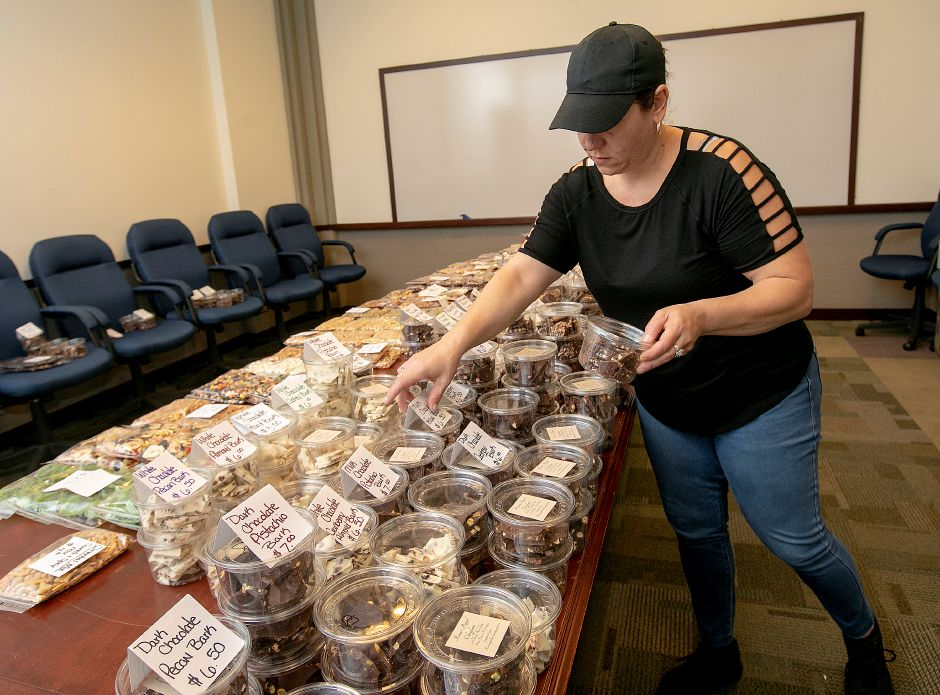 Chocolatier Rosie Okinsky sets up her chocolates for sale to state employees at 55 Farmington Ave. in Hartford Friday. Okinsky is moving her entire operation from New Jersey to Connecticut and hopes to open in Factory Square on Center Street in Southington in about two months.