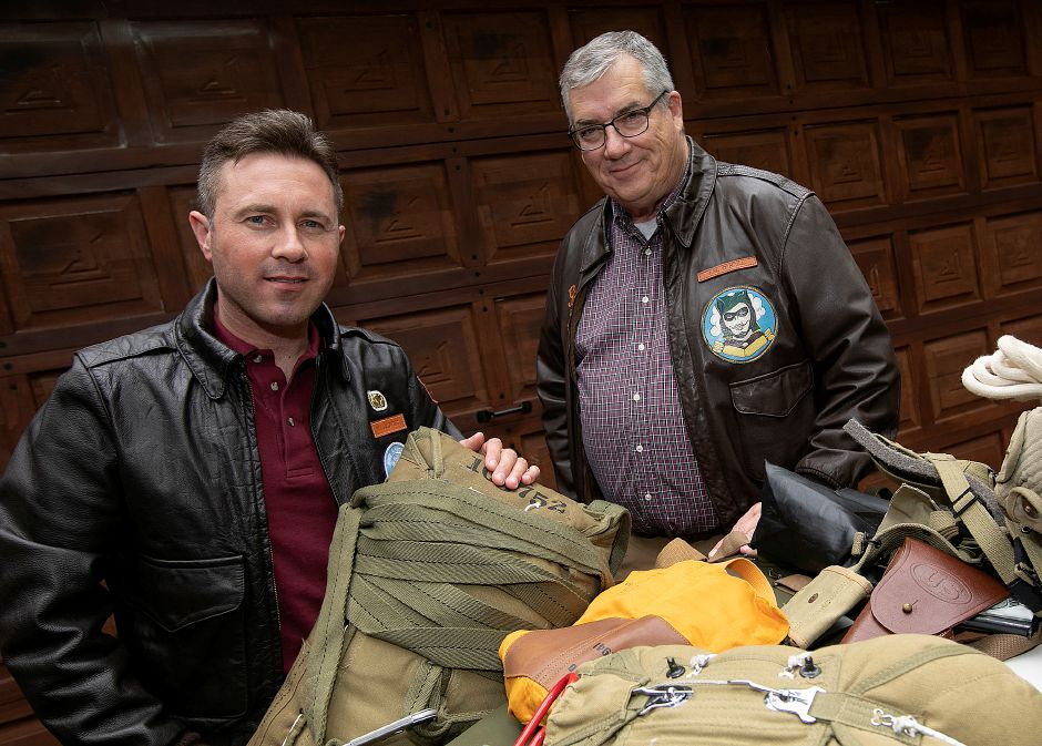 Matt Jalowiec, left, and Jerry O'Neill, of Cheshire, pose with combat jump gear Friday at Jalowiec