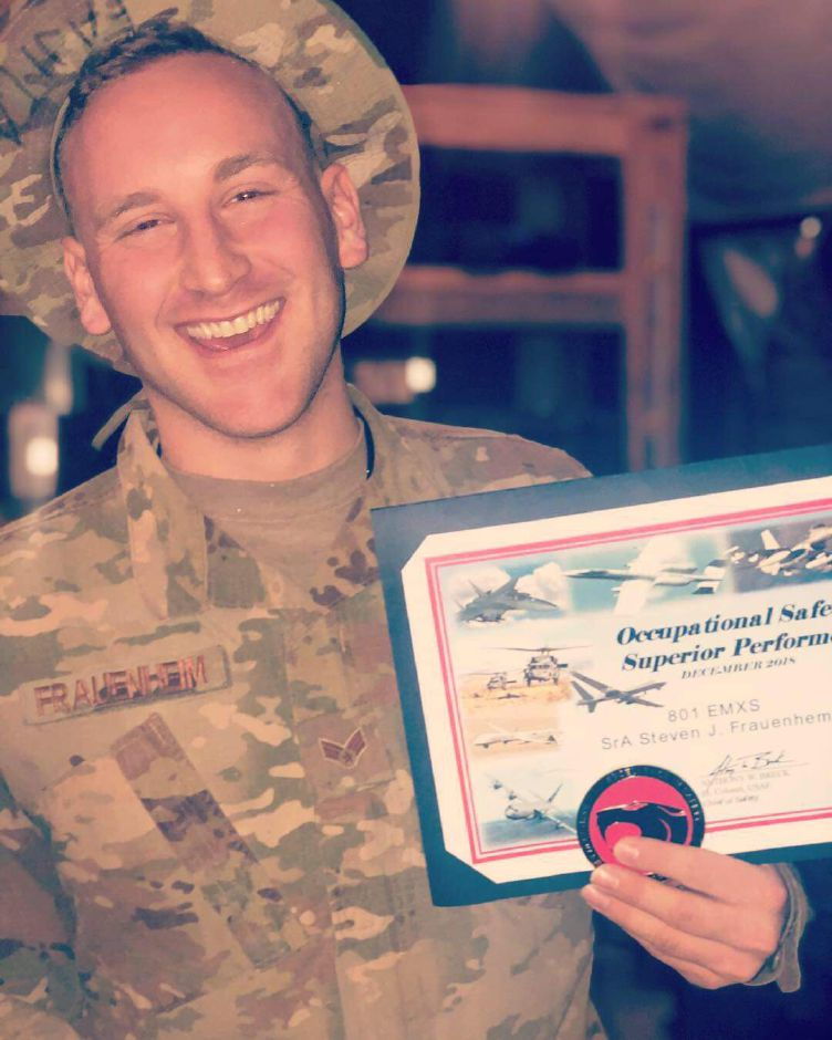 Steven Frauenheim, a 2012 Southington High School graduate, in Iraq with a recognition he received. Frauenheim is in the Air Force | Jim Frauenheim