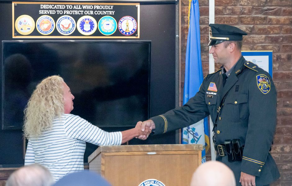 Kate Wall shakes hands with newly promoted Berlin Police Lieutenant Shawn Solek during a ceremony where he and Sergeant Rob Martin were welcomed into their new positions on August 26, 2019. | Devin Leith-Yessian/Berlin Citizen