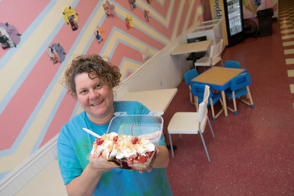 Michelle Caramanello, operations manager, shows a freshly made banana split at the new Banana