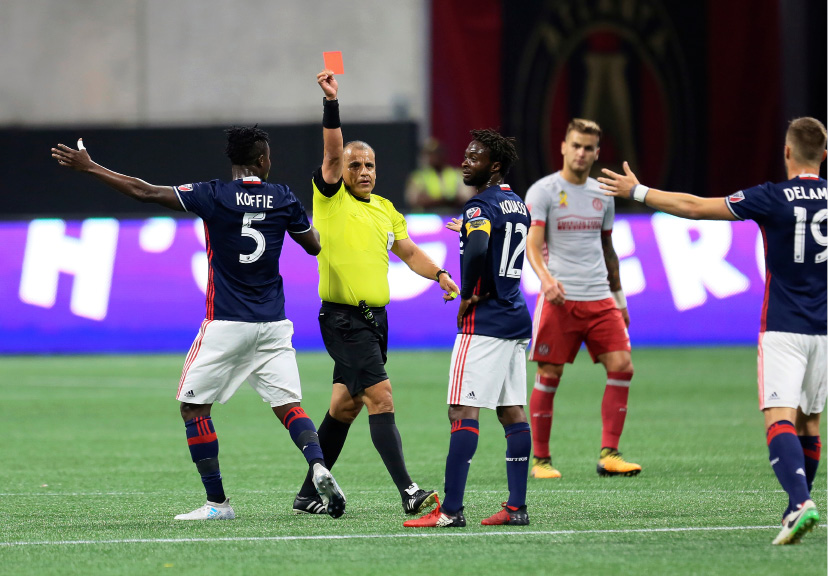 New England Revolution midfielder Xavier Kouassi (12) received a red card during an MLS soccer match against Atlanta United on Wednesday, Sept. 13, 2017, in Atlanta. (Miguel Martinez/Atlanta Journal-Constitution via AP)
