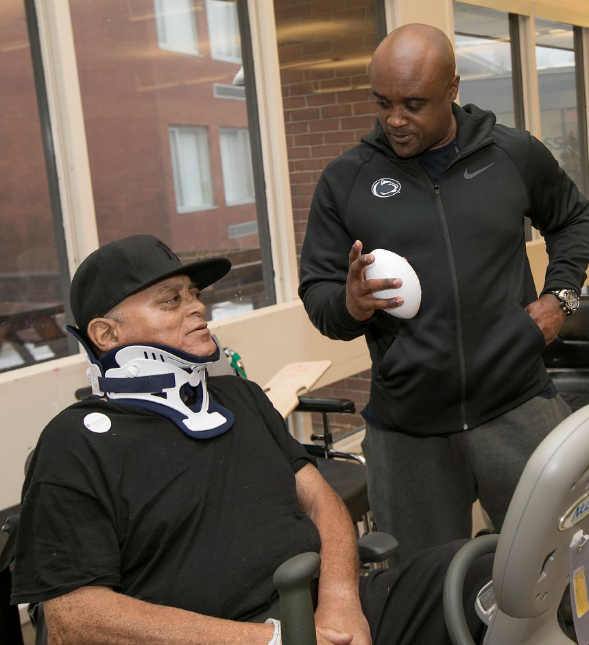 Ki-Jana Carter, a Penn State All-American, right, talks with patient Wayne Chambers, of Windsor, during Walter Camp day at Gaylord Specialty Healthcare in Wallingford, Friday, Jan. 12, 2018. Carter also played for the Cincinnati Bengals, Washington Redskins and New Orleans Saints. Dave Zajac, Record-Journal