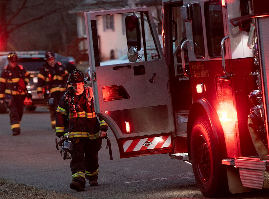 Meriden firefighters walk back to their trucks after putting out a fire at 121 Belvedere Dr. in Meriden, Mon., Jan. 7, 2019. There were no reports of injuries. Dave Zajac, Record-Journal