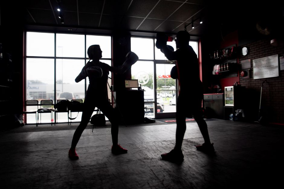 Record-Journal Digital Content Producer Ashley Kus practices punching with Christian Pagan of Waterbury at the 9Round Fitness facility in Wallingford Sept. 24, 2018. | Richie Rathsack, Record-Journal