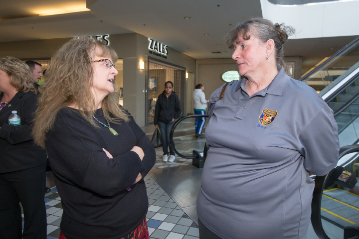 FILE PHOTO -- Doree Price, left, and Andrea Lorenzetti speak before the presentation Wednesday during the Meriden Public Health and Safety Awards at the Westfield Mall in Meriden Lorenzetti received the recognition for the June 16 911 call at the Westfield Mall. Nov. 2, 2016 | Justin Weekes / For the Record-Journal