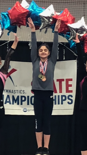 Alison Albanese, a seventh grade student at Strong Middle School, recently won the state championship in gymnastics at the University of New Haven. Albanese trains at Connecticut Gymnastics Academy in Wallingford.