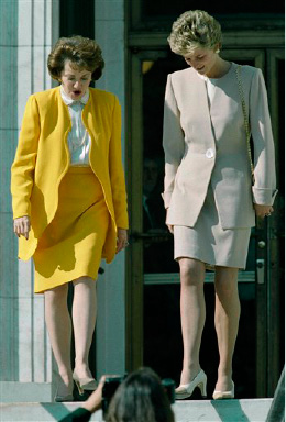 Princess Diana is escorted by Red Cross President Elizabeth Dole after a visit in Washington, Oct. 21, 1994. Diana, vice president of the British Red Cross, met with Dole to discuss issues confronting their organizations. (AP Photo/Joe Marquette)