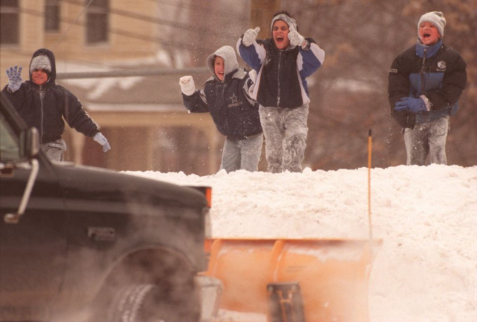 RJ file photo - Left to right, Christian Santiago, 8, Anthony Gonzalez, 10, Samuel Santiago, 11, and Kenneth Valasquez, 11, give the thumbs up to a snow plow operator Richard Pleines as they watch him safely from the other side of the snow Jan. 14, 1999. Pleines was clearing the parking lot of St. Rose Church in Meriden.